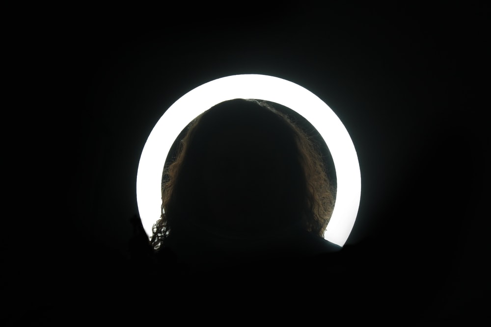 silhouette of person on against white light