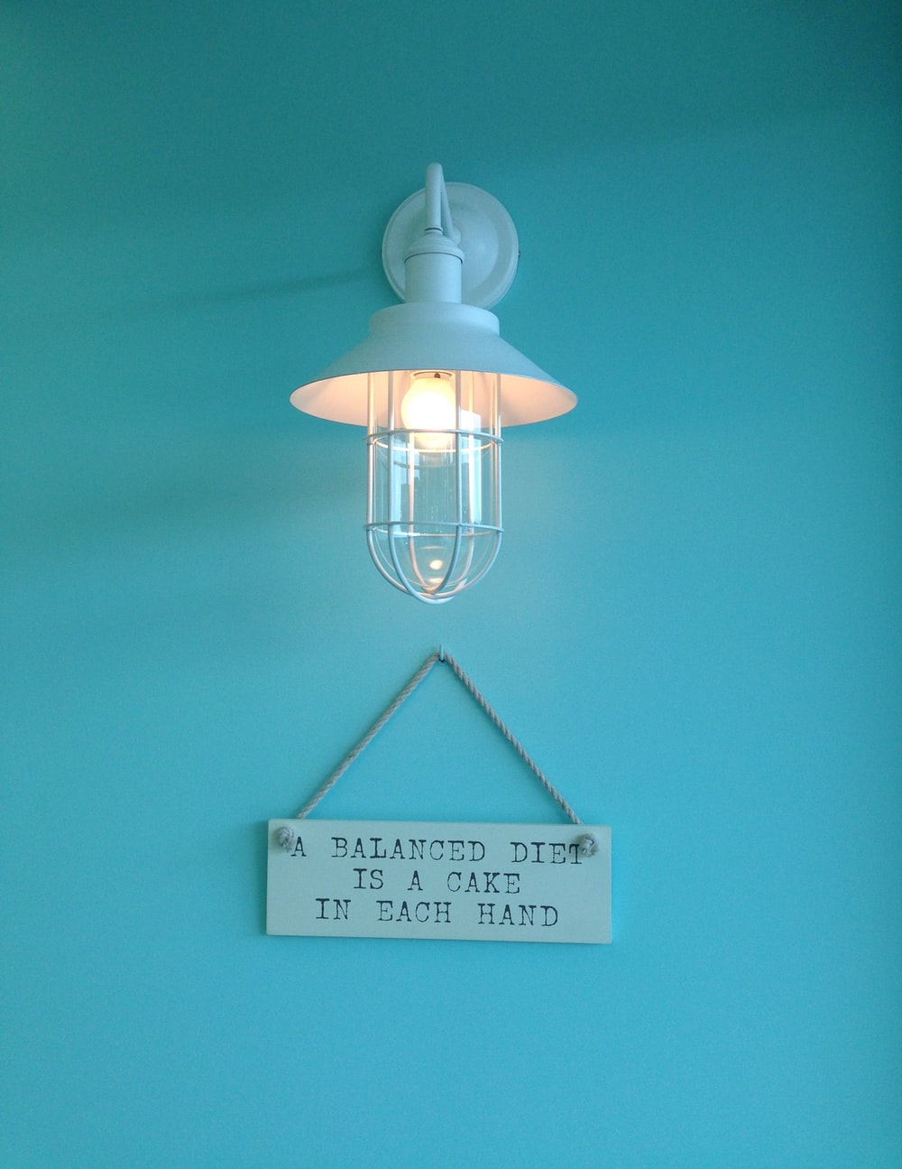 turned-on white wall lamp