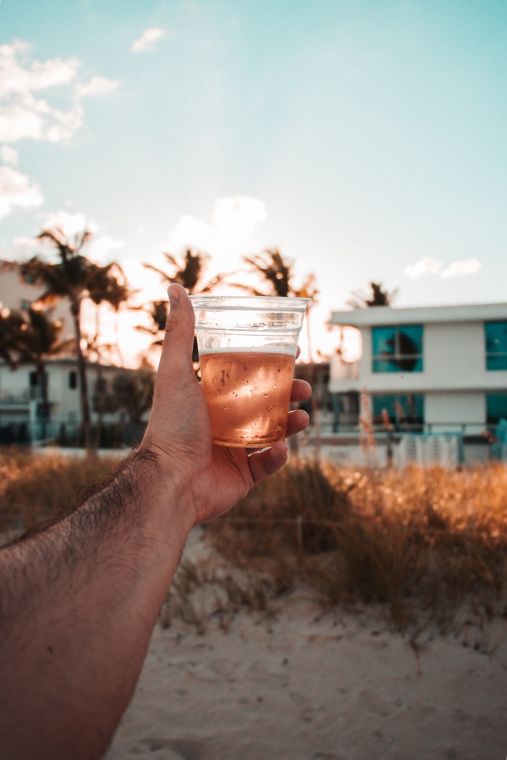 man holds glass of beer