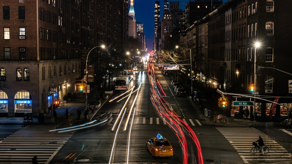 timelapse photography of busy intersection at night
