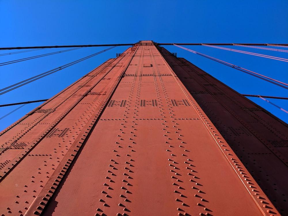 orange metal bridge during day time