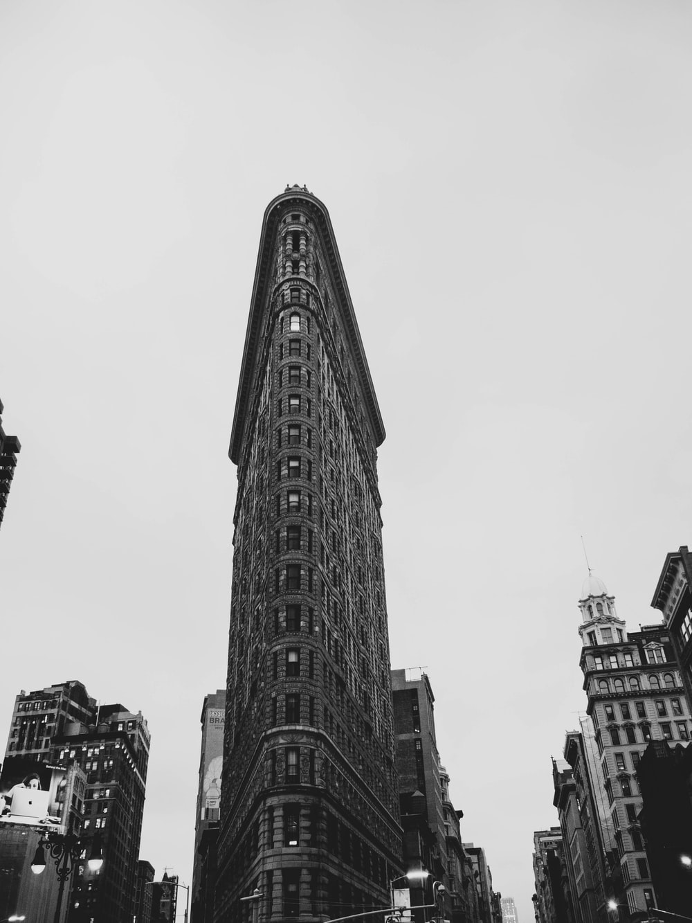 grayscale photography of flat iron building