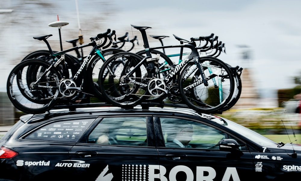 road bikes on top of black SUV