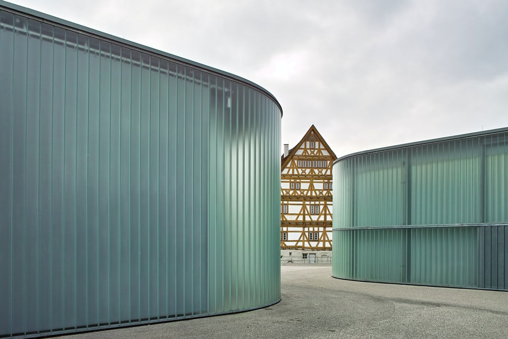 two blue containerized housing units