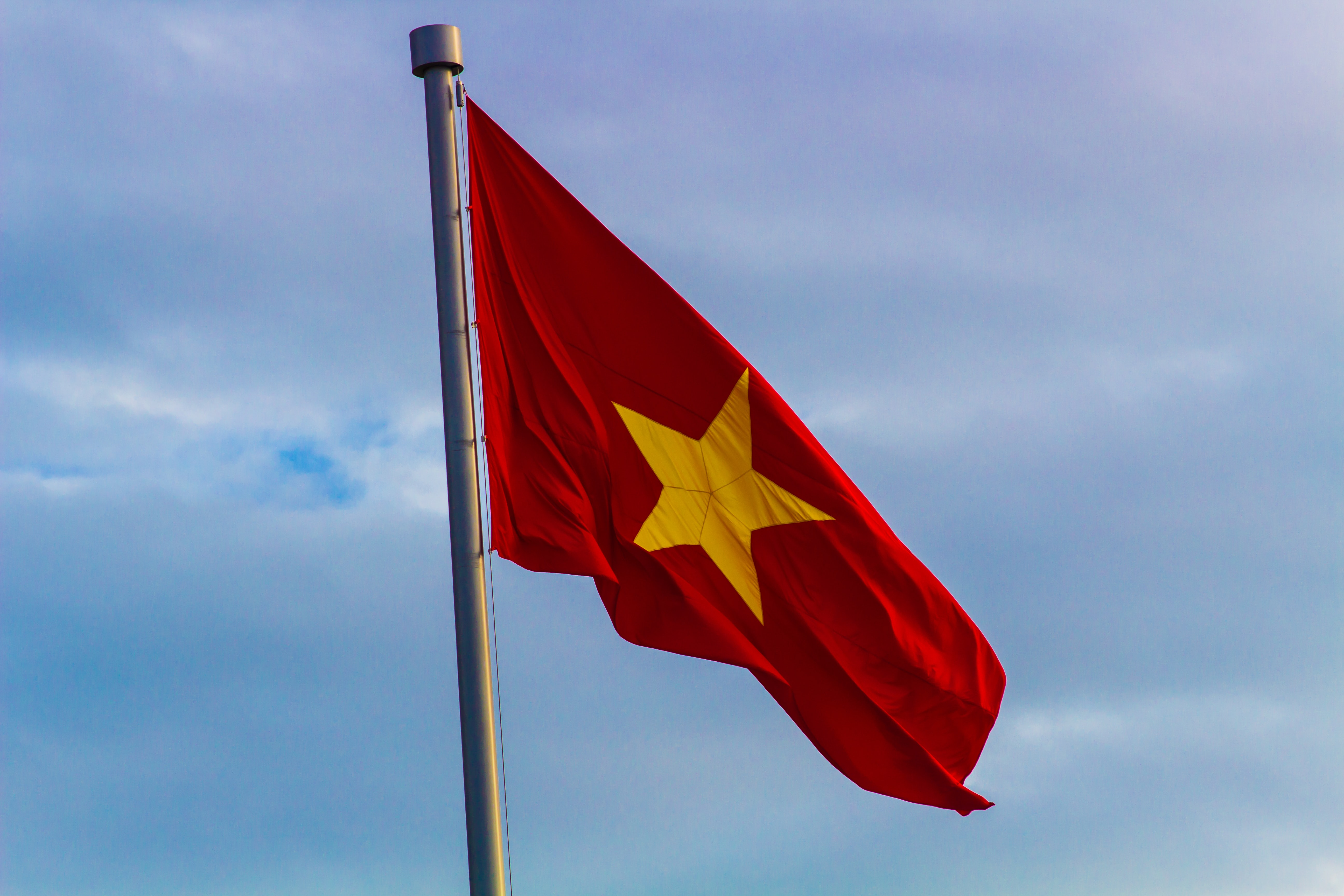 red and yellow flag with star on pole