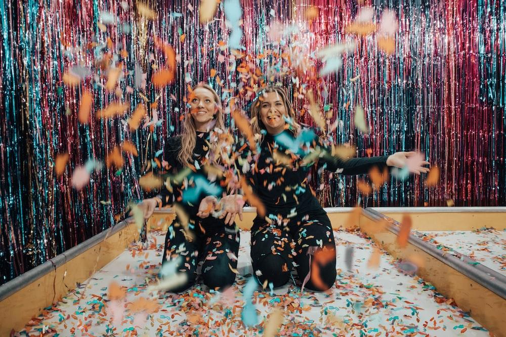 two women enjoying confetti