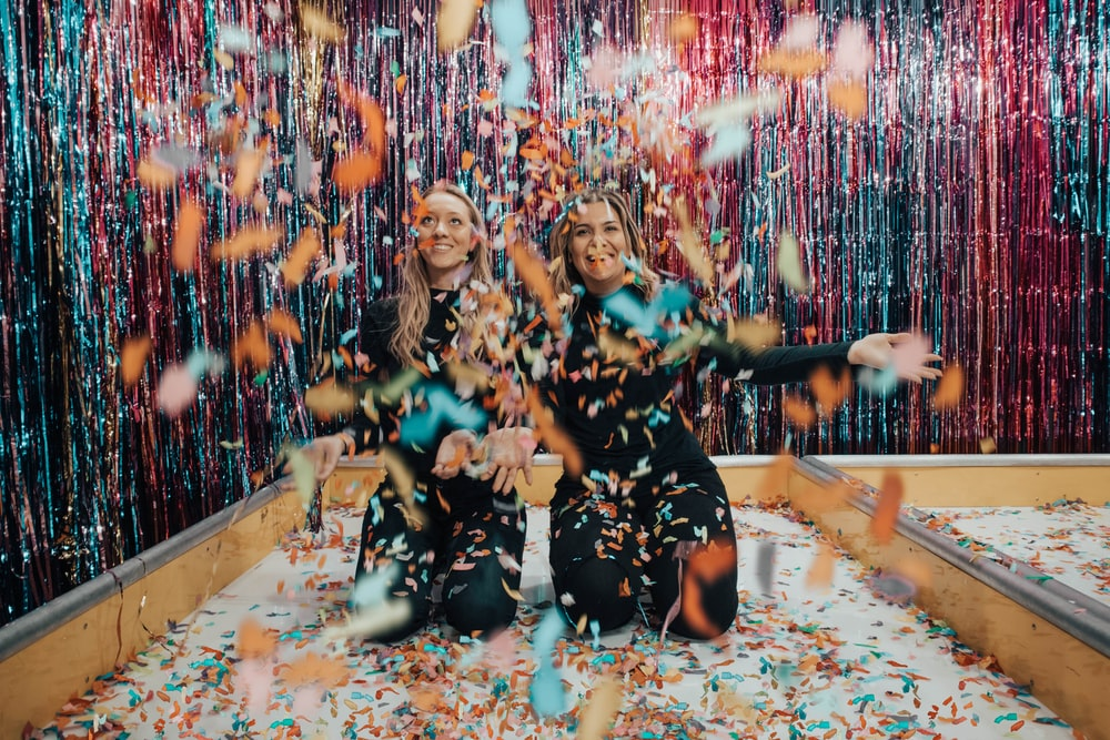 two women enjoying confetti