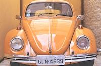 yellow Volkswagen Beetle parked inside room