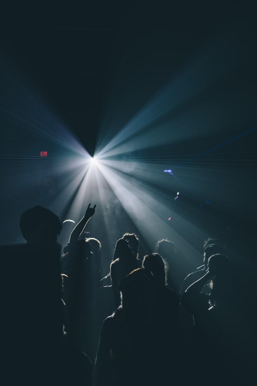silhouette of people inside dark room