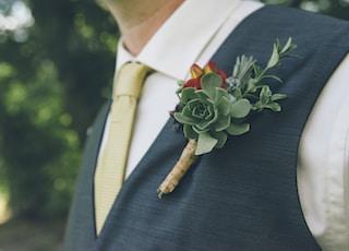 man wearing green succulent brooch