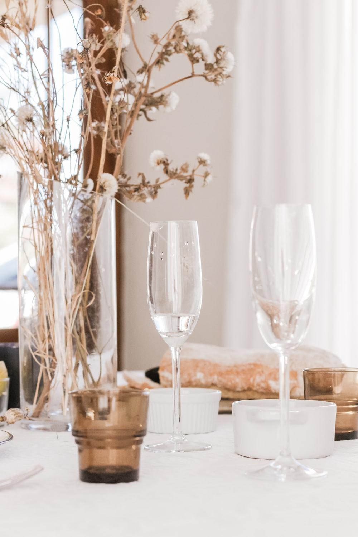 champagne glasses beside flower centerpiece