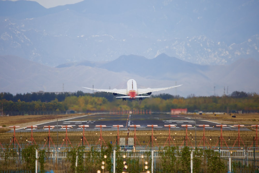 airliner taking off from airport during day