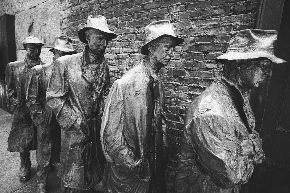 concrete statues near wall