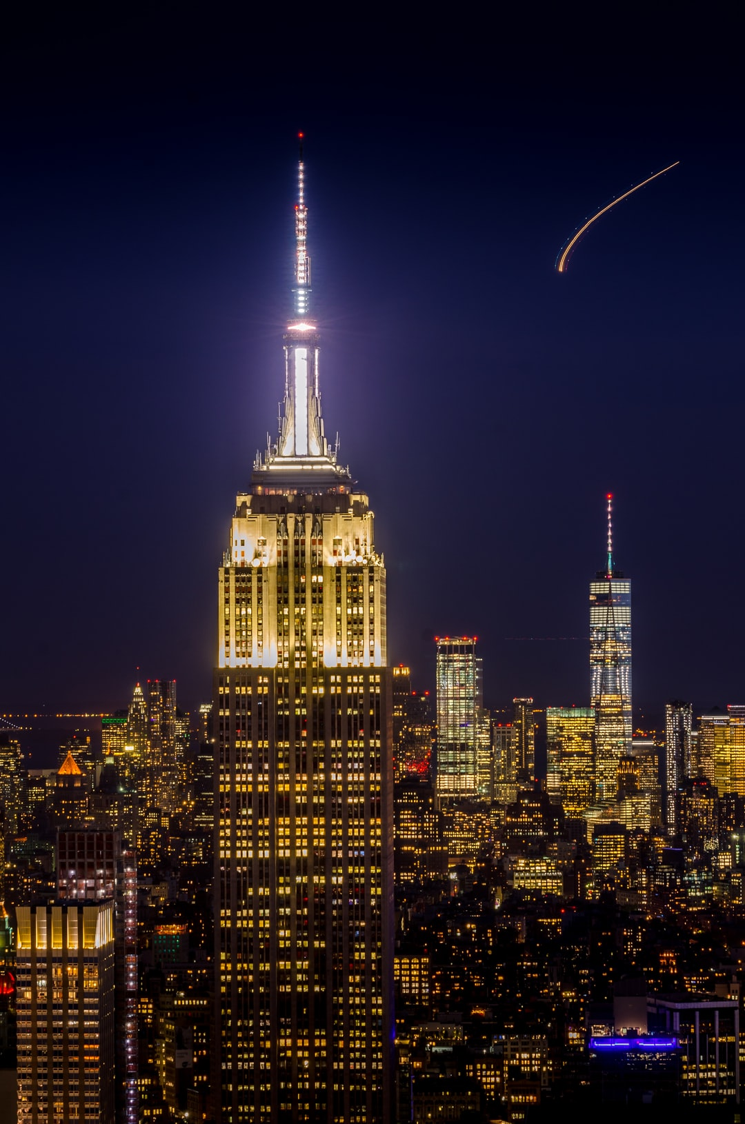 Empire State Building & New York City Skyline At Night