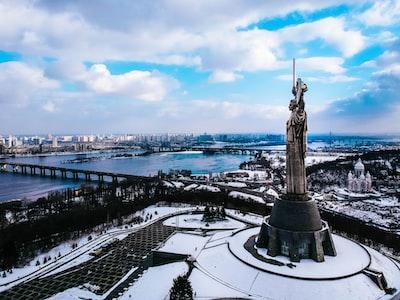 brown concrete statue under white cloudy sky ukraine zoom background
