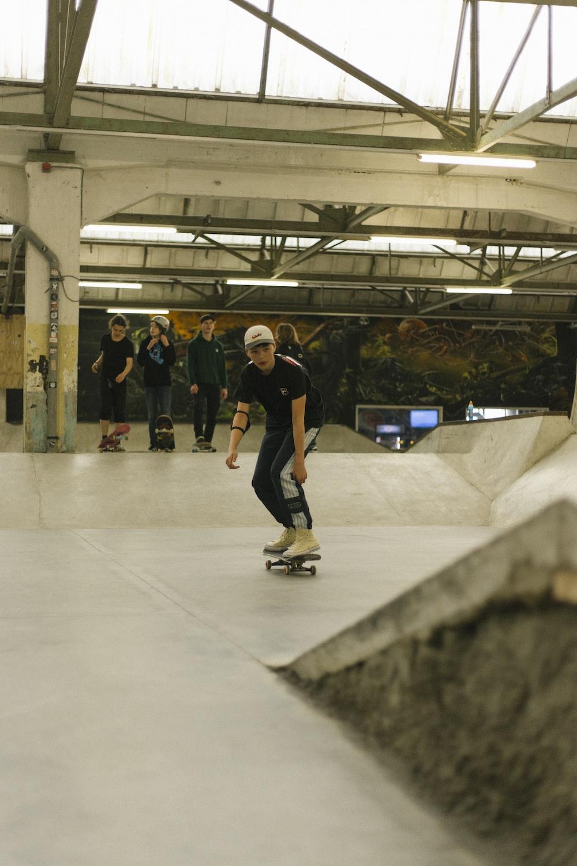 man playing skateboard near ramp