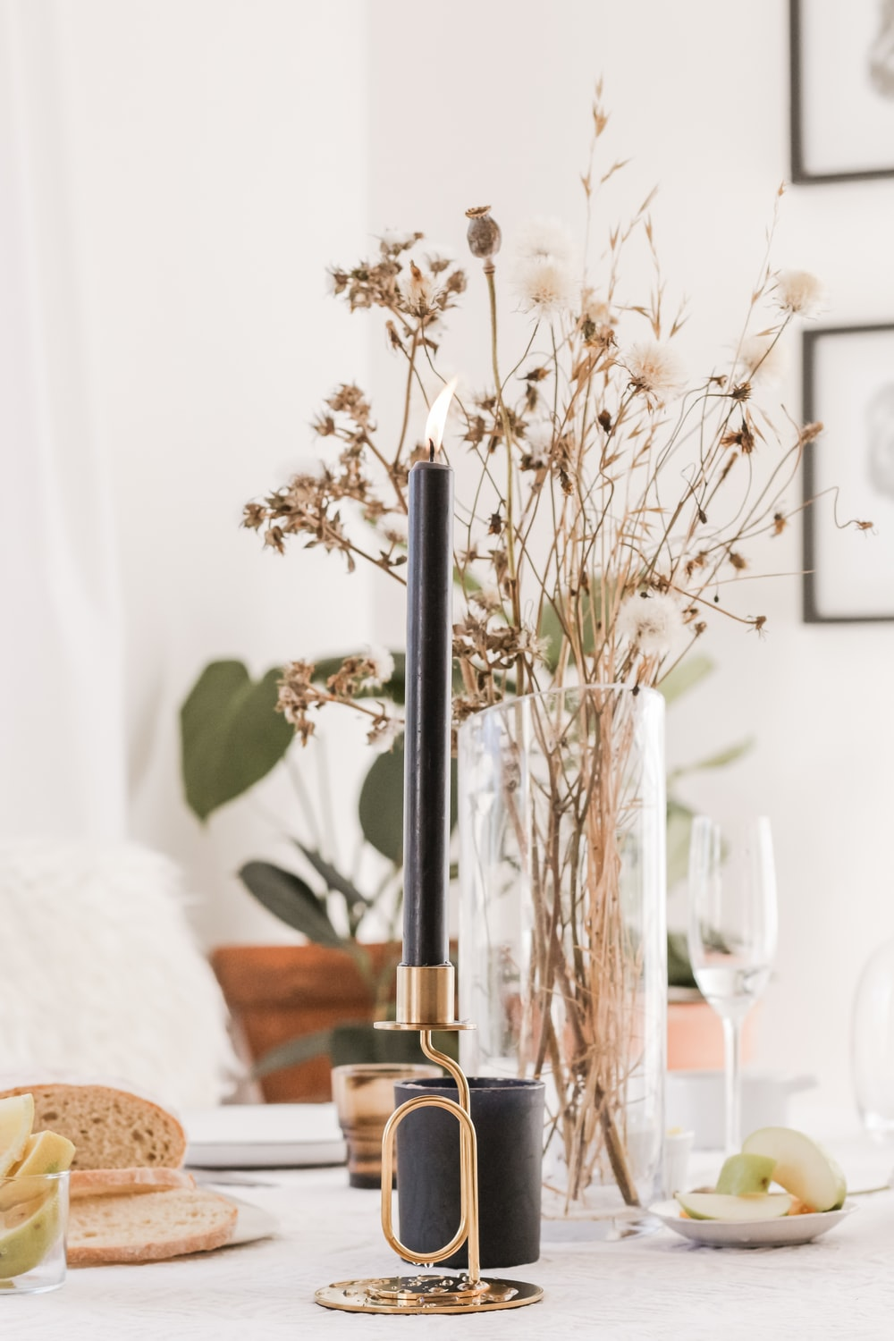 black and gold candle stick on white wooden table