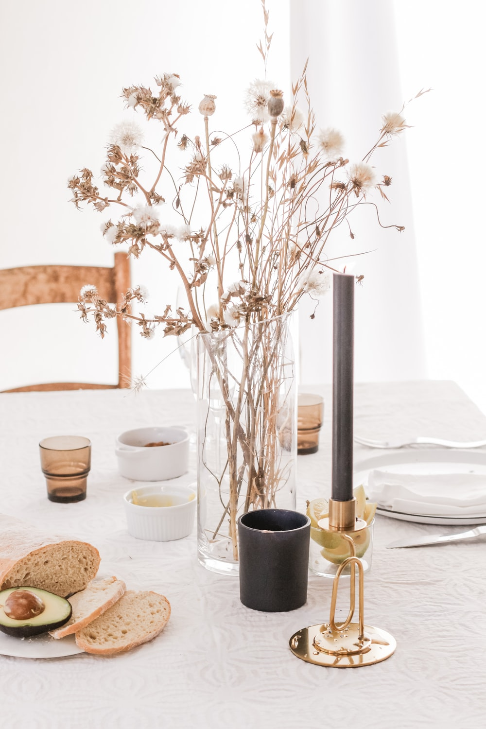 bread and flower placed on table