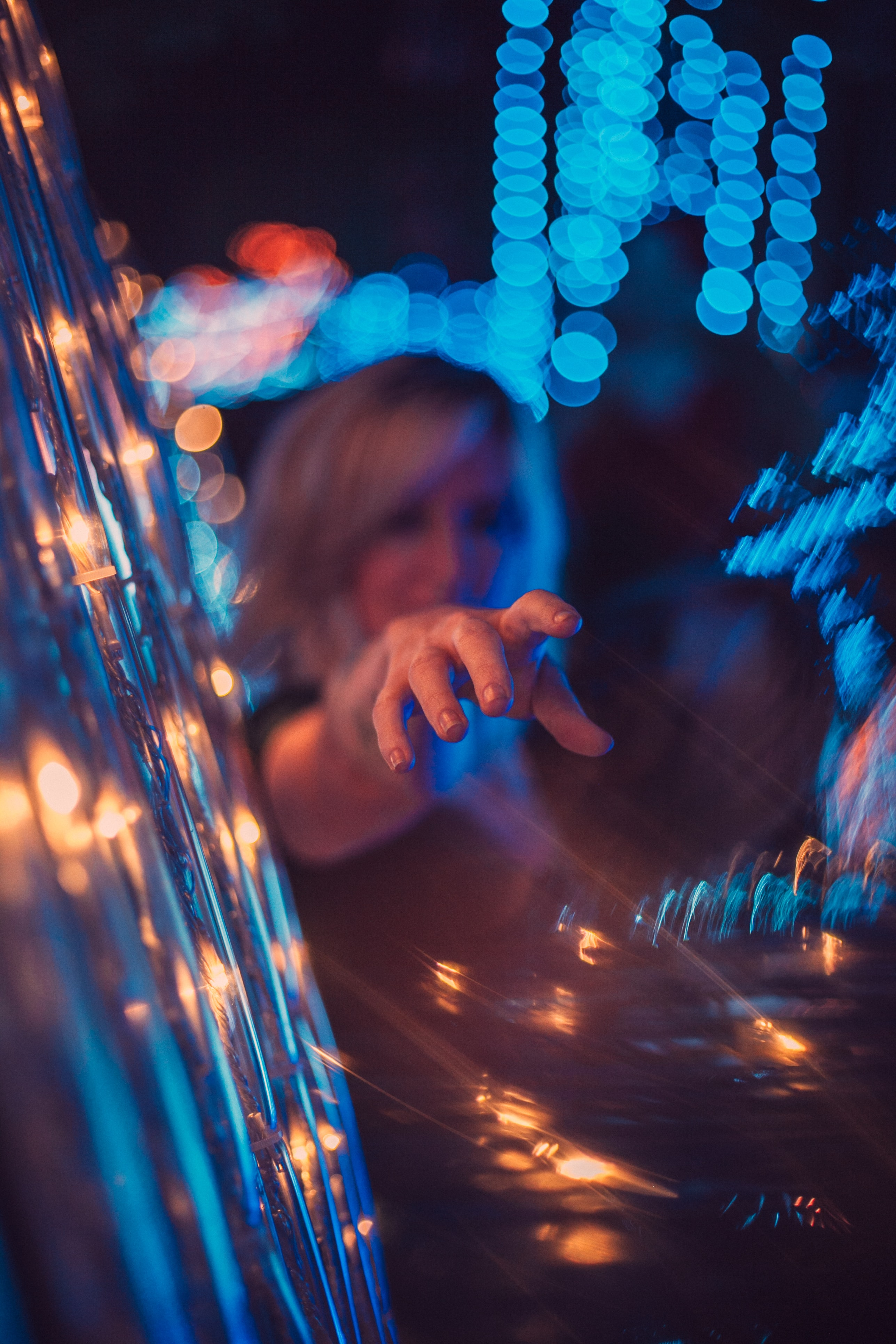 woman surrounded with blue lights