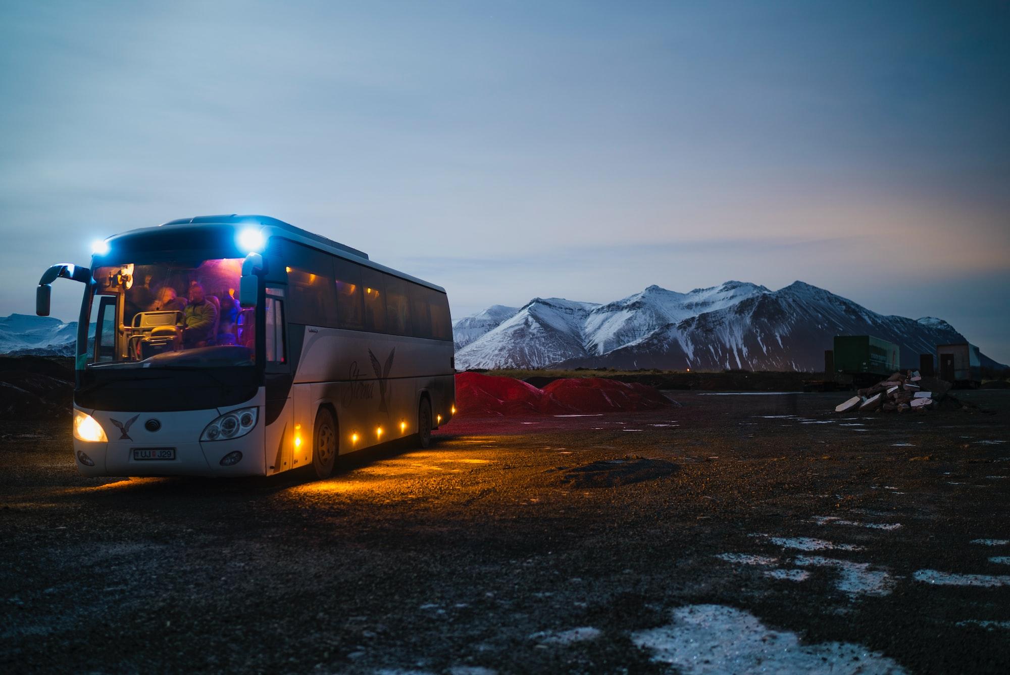 Large passenger bus driving through the mountains