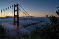 On my first trip to SF I was in a conference mostly, but I had a chance to check out the sunrise one day. As we took a Lyft from the hotel to Battery Spencer the fog was so bad that you couldn't even tell you were on the bridge; even when we were dropped off at the parking lot you couldn't see anything. The short walk from the parking lot to the viewpoint put me above the clouds and I was blessed with the most amazing view of Golden Gate I could imagine. As the sun rose the fog would hide and reveal the bridge in the most amazing ways.   I took so many good photos of this, more in profile.