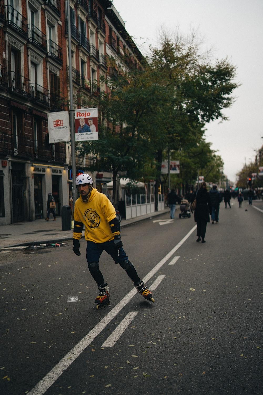 man on road while wearing inline skates