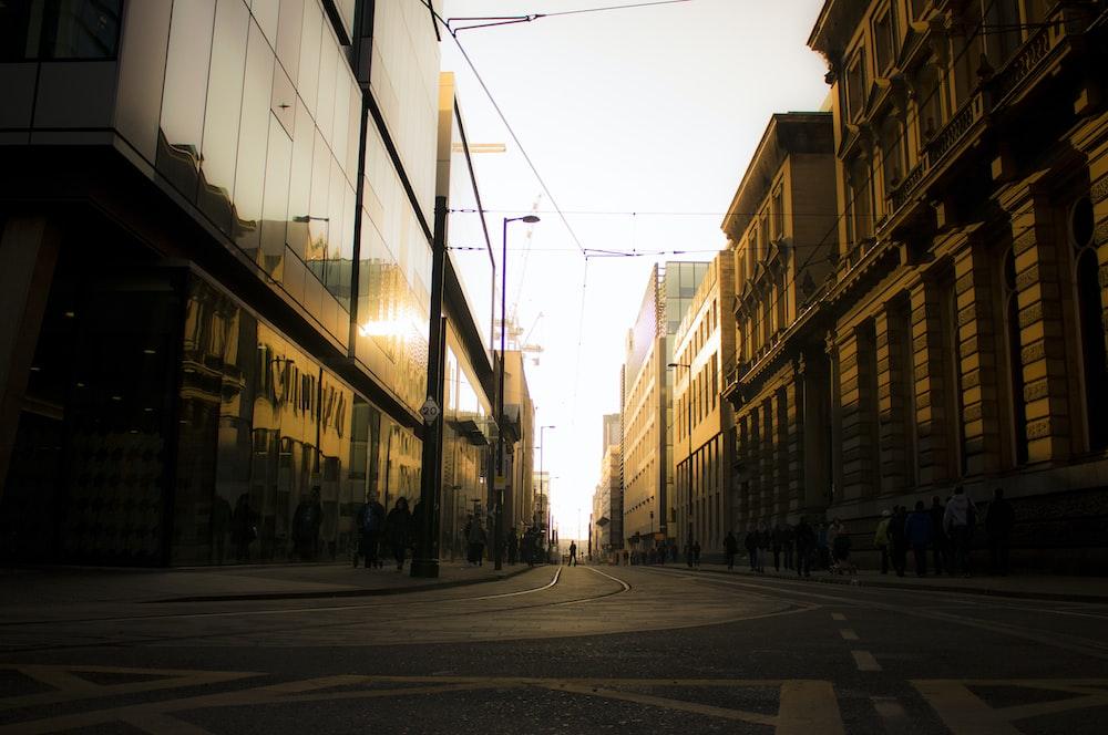 empty road in between buildings