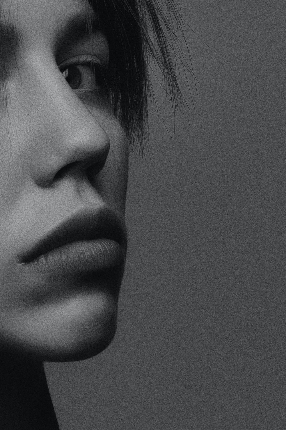 person's face in greyscale photography