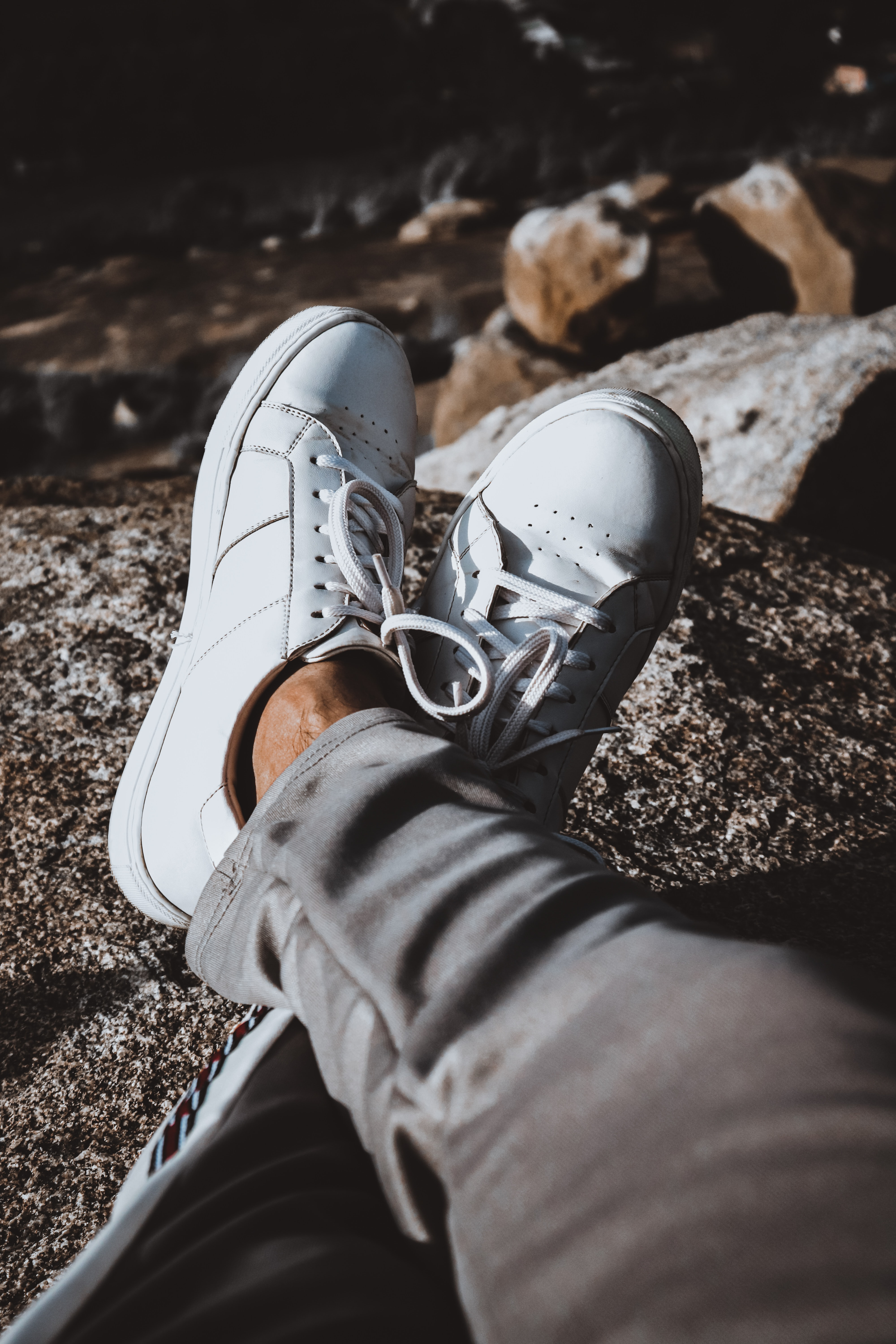 pair of white low top sneakers