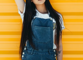 woman wearing blue denim dungaree pants
