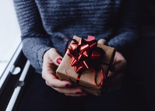 person holding present box