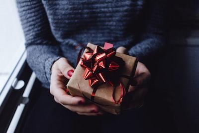 person holding present box