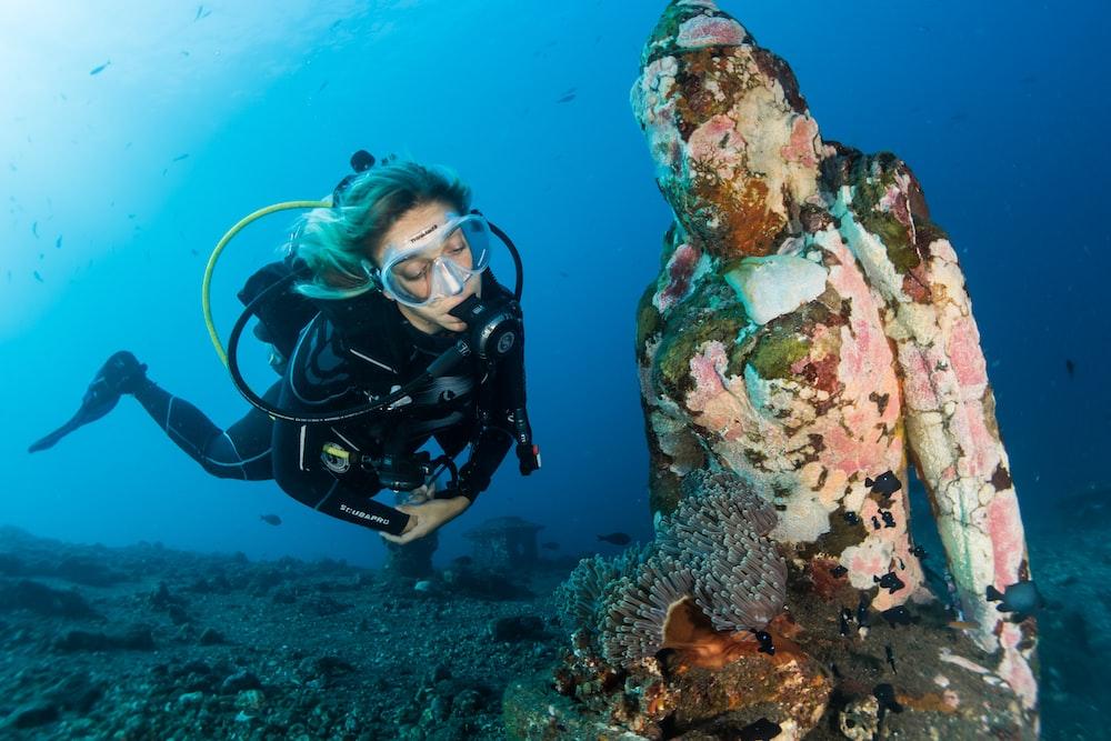 woman scuba diving under water