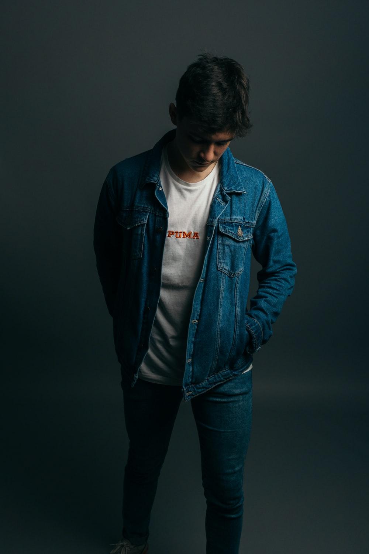 man wearing blue denim jacket