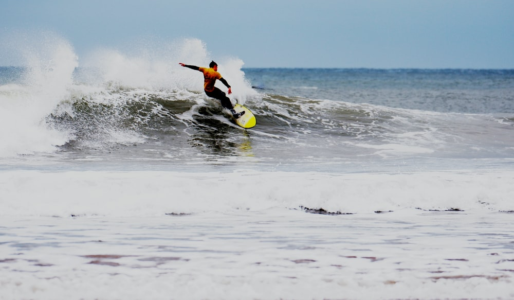 surfer wearing wet suit during daytime