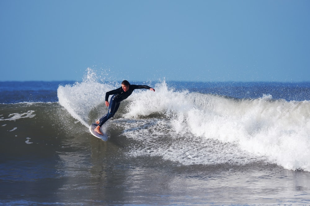 person dsurfing. croyde beach, day trips from Exeter