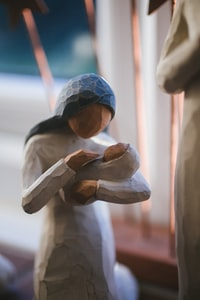 brown and black ceramic figurine