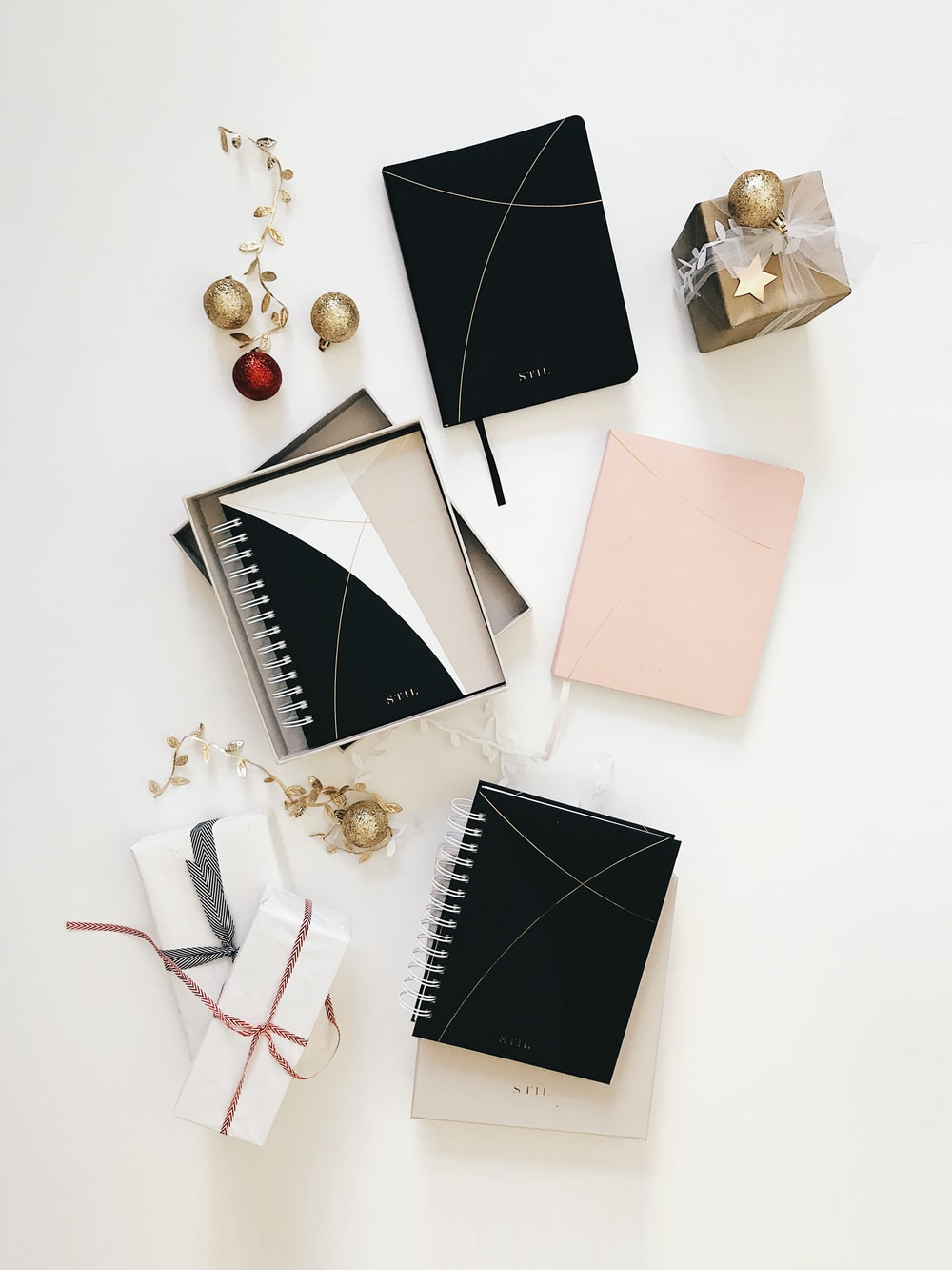 black spiral notebook on white surface