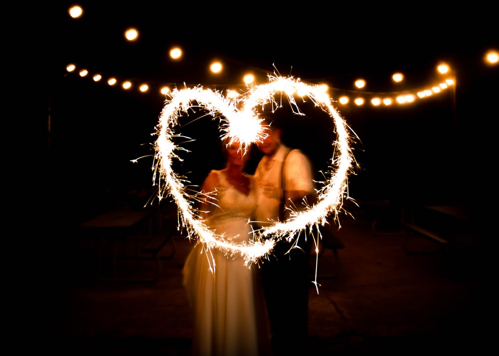 man and woman doing light writing photography