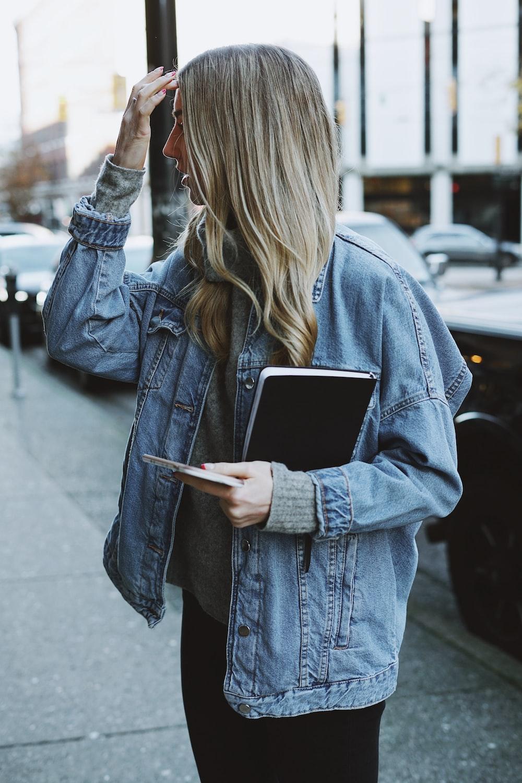woman holding black book