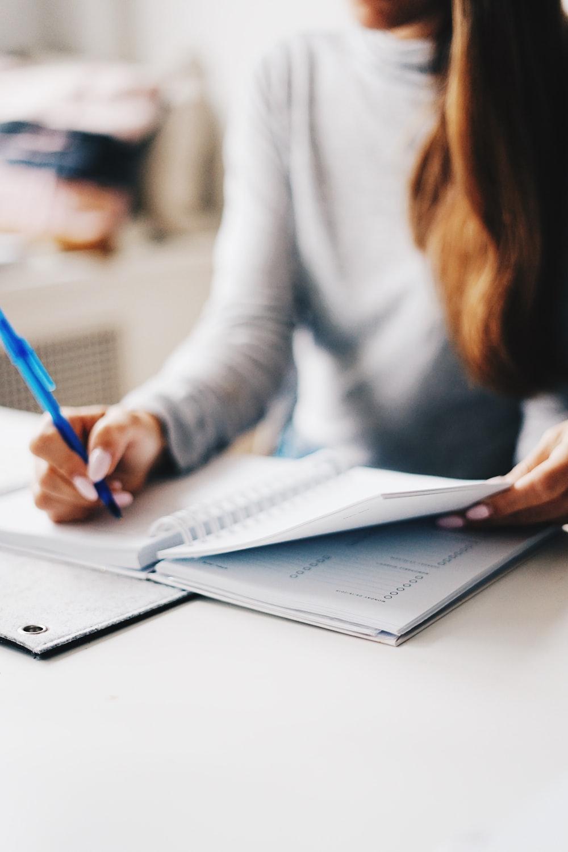woman writing using pen