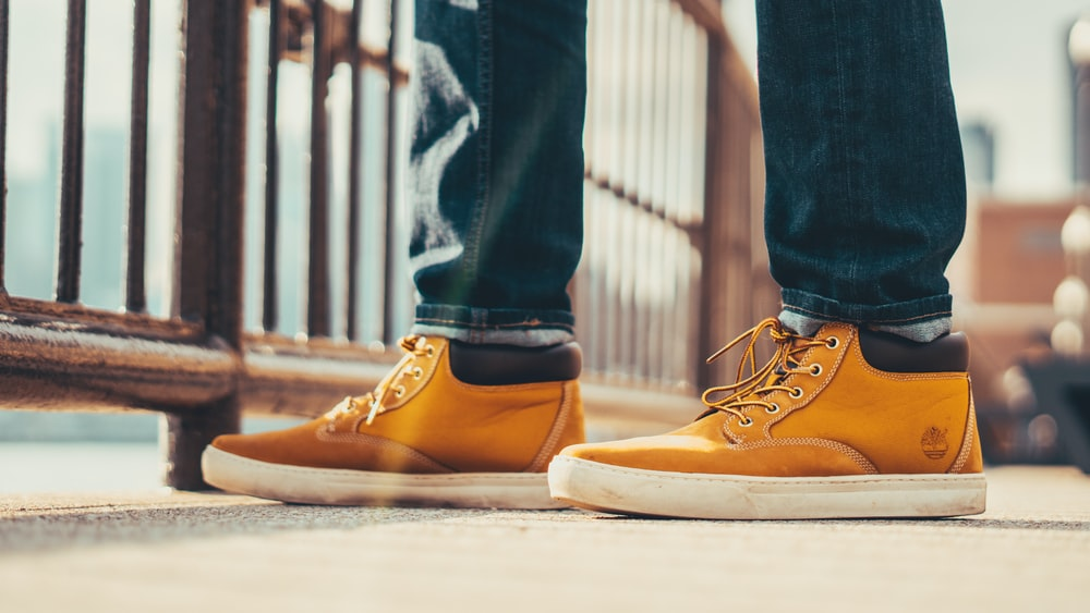 person wearing brown Timberland shoes