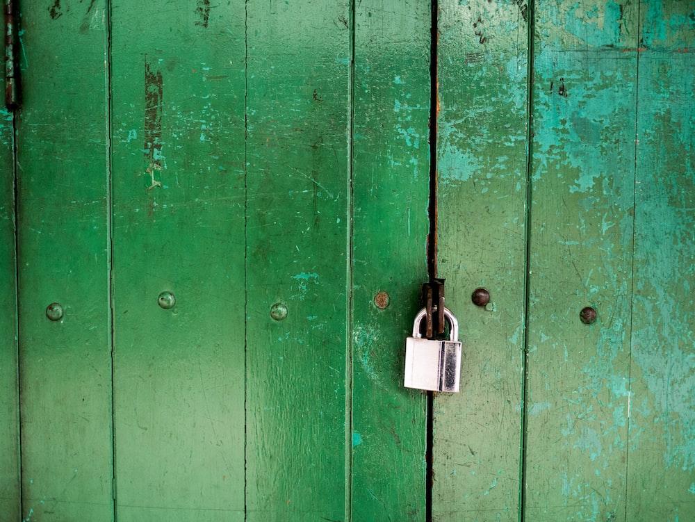 green wooden door closed