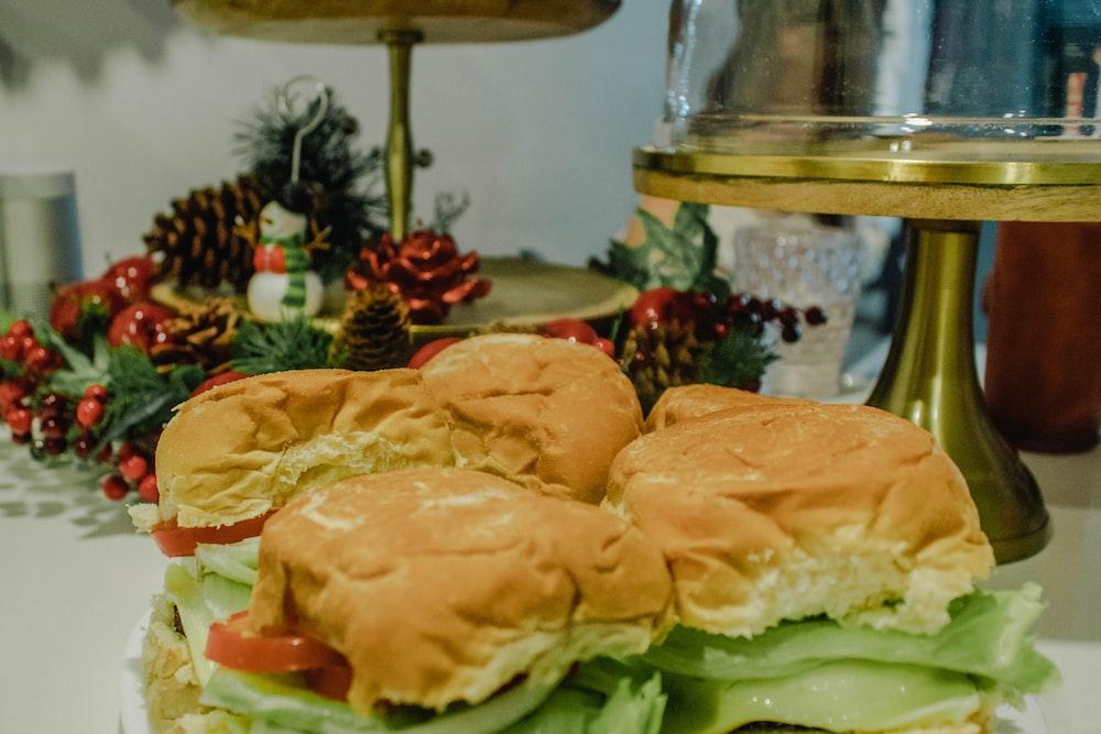 four burgers on table