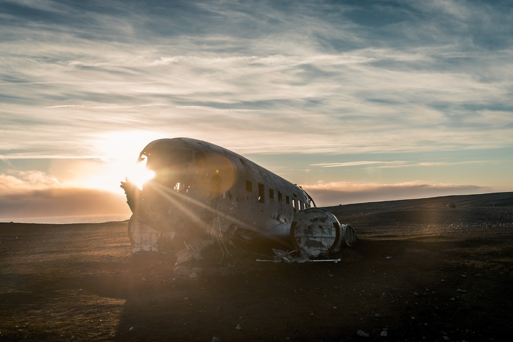 wrecked plane on sand field