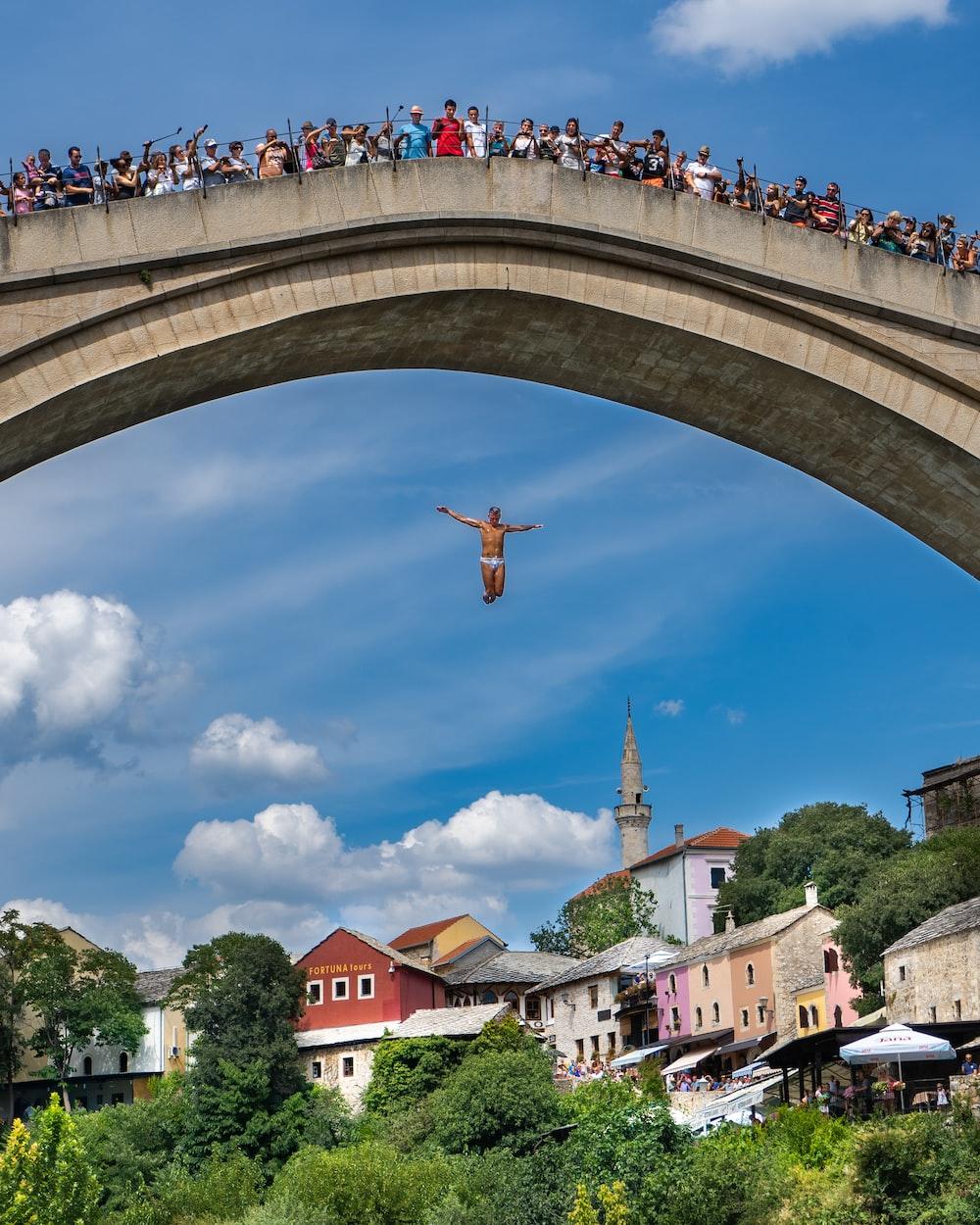 people on bridge at daytime