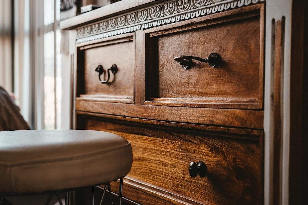 brown wooden drawer chest