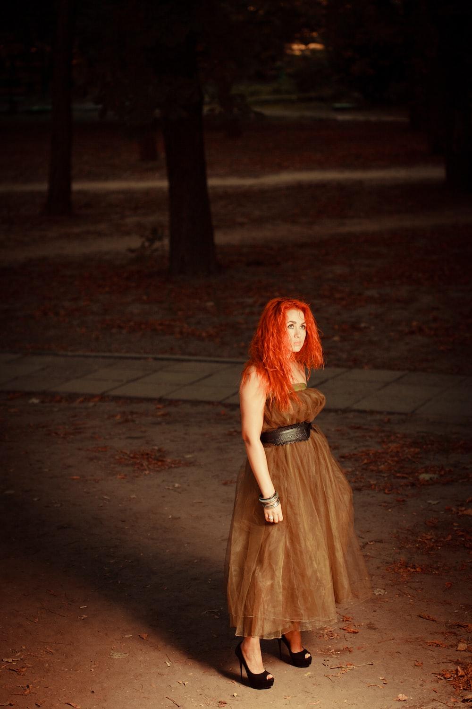 woman standing near pavement