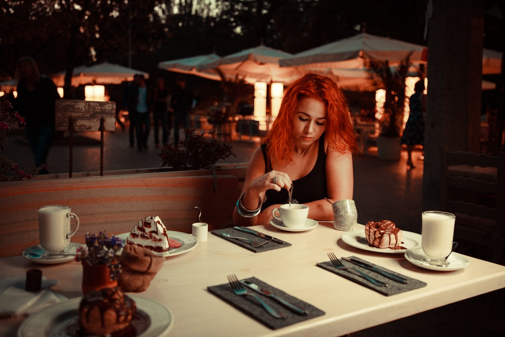 woman sitting on teacup on sauce