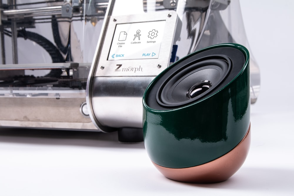 green and brown portable speaker